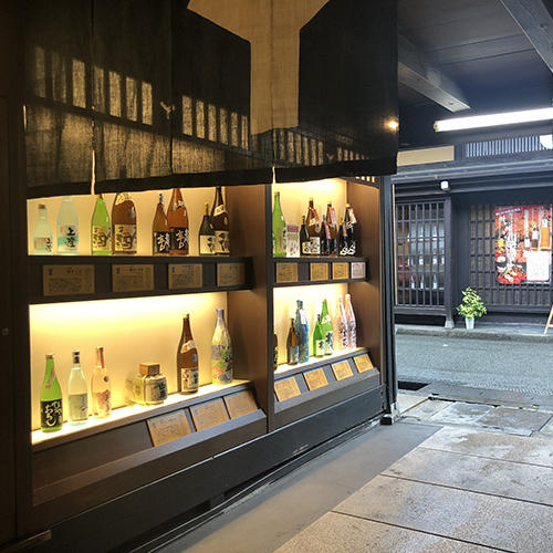 wall with sake bottles on display