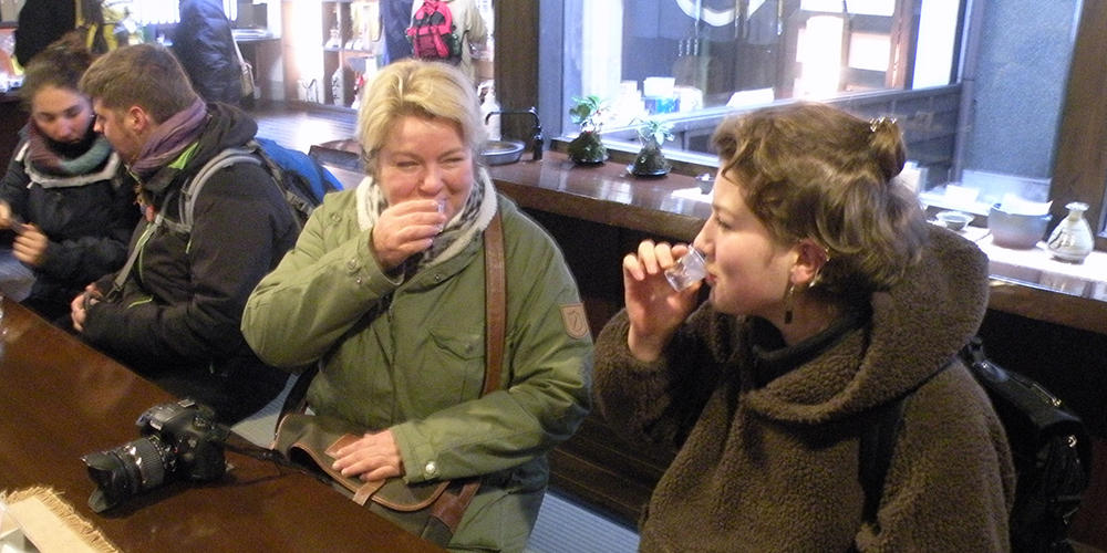 two women drinking sake